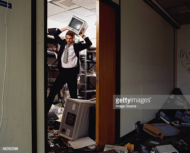 Businessman throwing computer components