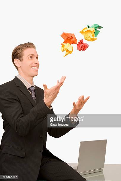 Businessman throwing crumpled papers