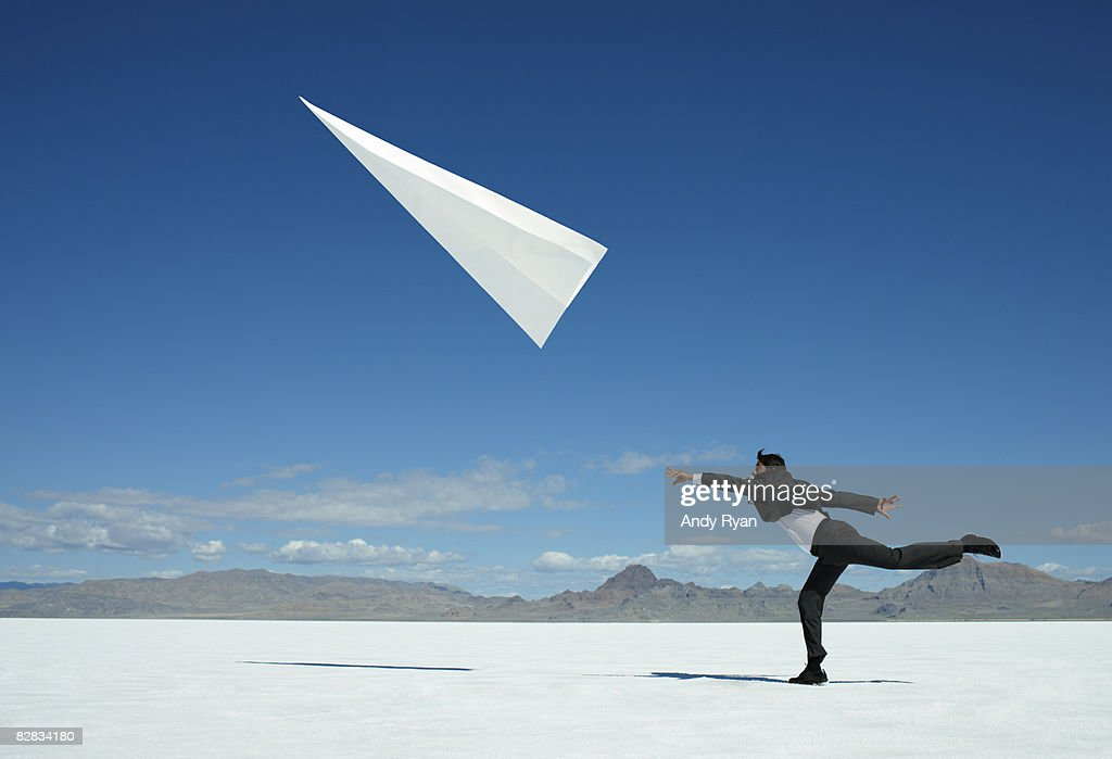 Businessman Throwing Giant Paper Airplane.