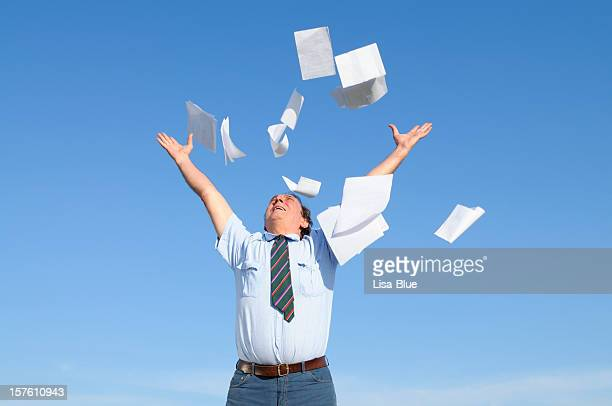Businessman Throwing Papers Blue Sky