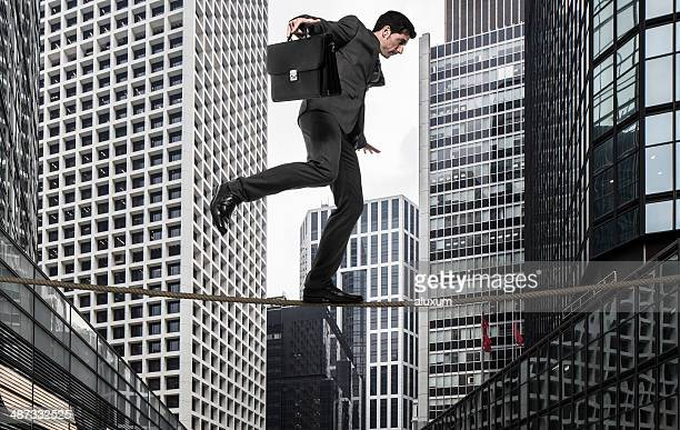 Businessman tightrope walker
