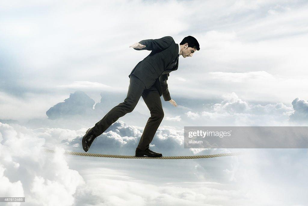 Businessman tightrope walker