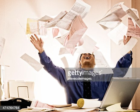 Businessman Tossing Documents.