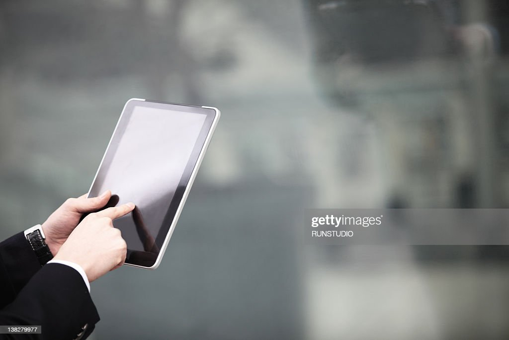 businessman touching digital tablet,hands close-up : Stock Photo