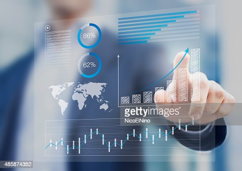 Businessman touching financial dashboard with kpi : Stock Photo