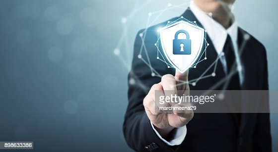 Businessman touching shield protect icon, Concept cyber security safe your data : Stock Photo