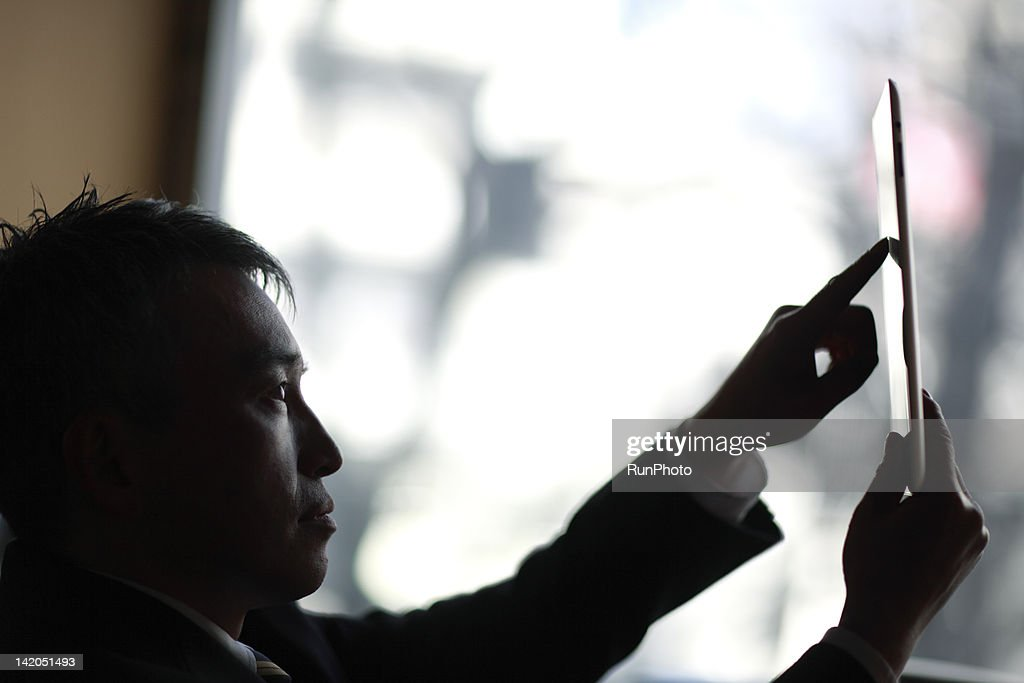 businessman touching tablet computer : Stock Photo