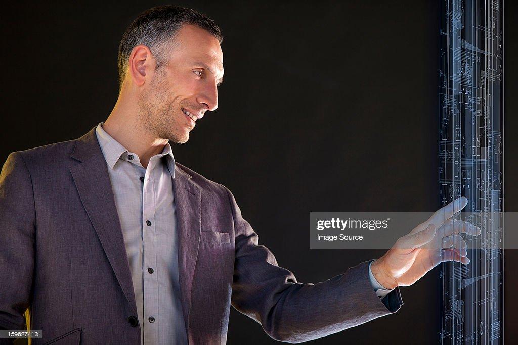 Businessman touching virtual information : Stock Photo