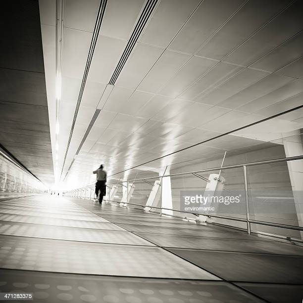 Businessman travelling into the light.
