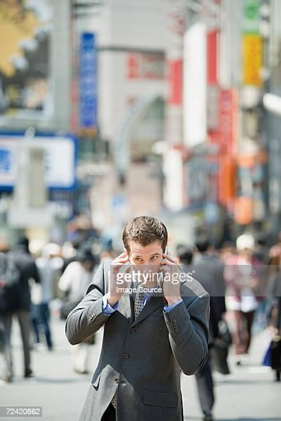 ビジネスマン中に聴く携帯電話用