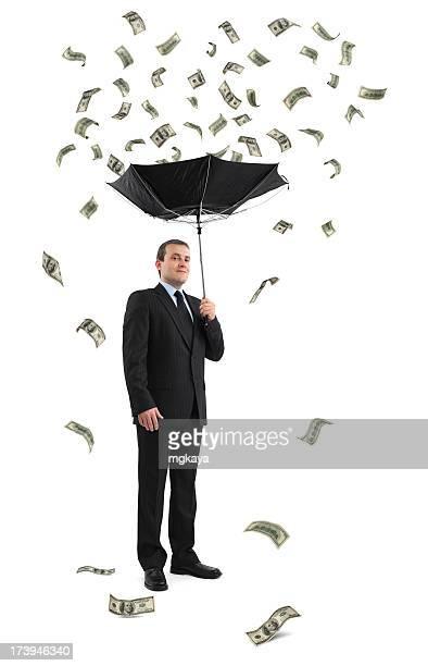 Geschäftsmann unter Geld-Regen