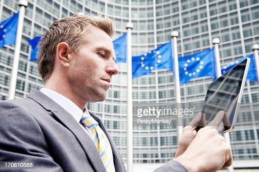 Businessman Uses Digital Tablet Computer at European Commission Brussels