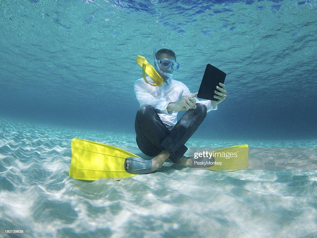 Businessman Uses Digital Tablet Underwater in Tropical Sea : Stock Photo