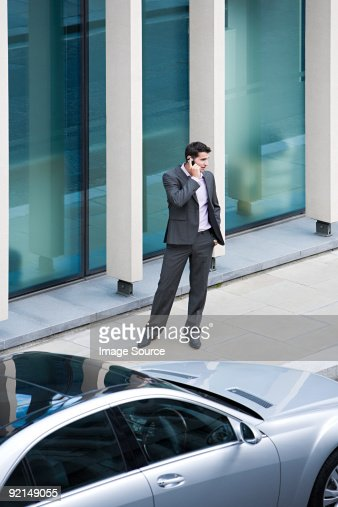 Businessman using a cellular telephone : Stock Photo