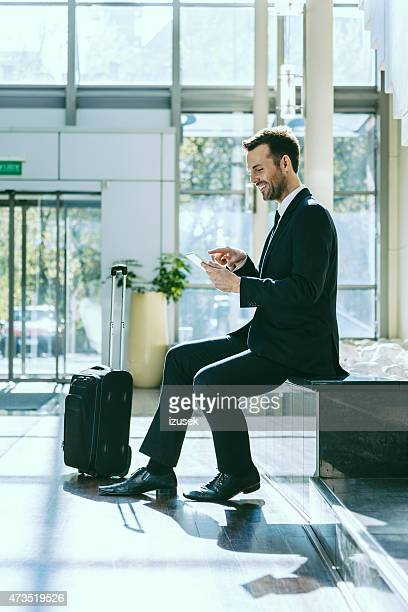 Businessman using a digital tablet in hotel hall