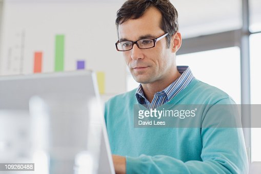Businessman using a laptop : Stock Photo