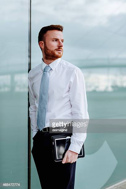 Businessman using a tablet.