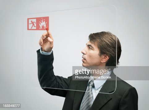 Businessman using advanced touch screen technology : Stock Photo
