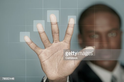 Businessman using biometric technology : Stock Photo