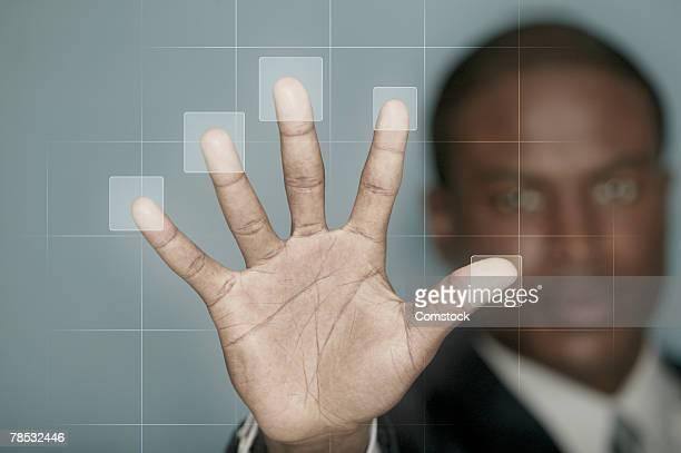 Businessman using biometric technology