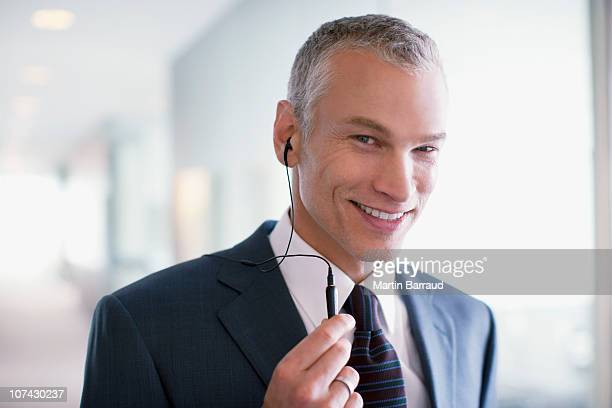 Businessman using cell phone hands-free device