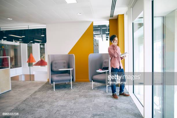 Businessman using cell phone in creative office
