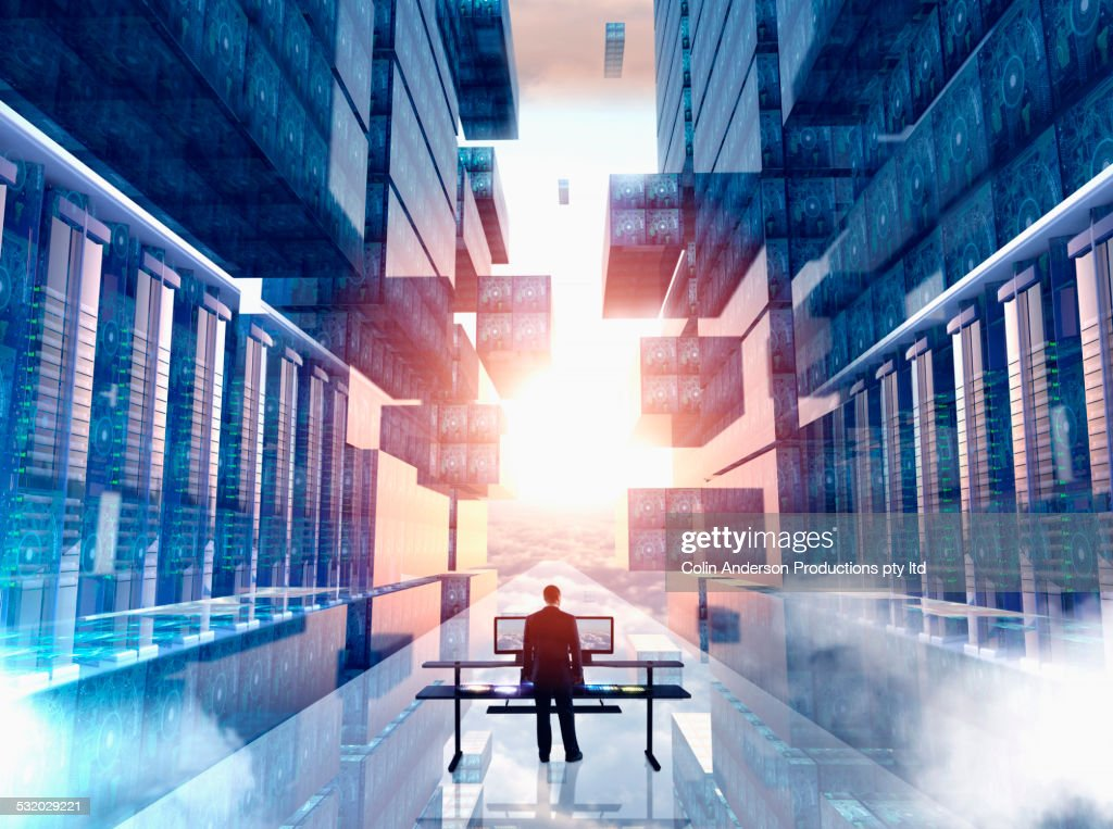 Businessman using computer in virtual server room