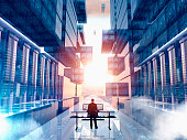 Businessman using computer in virtual server room