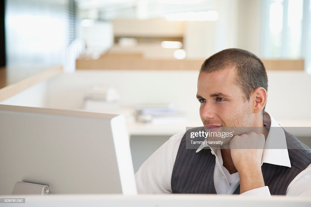Businessman using computer : Bildbanksbilder