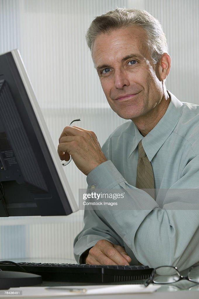 Businessman using computer : Stock Photo