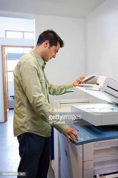 Businessman using copy machine in office