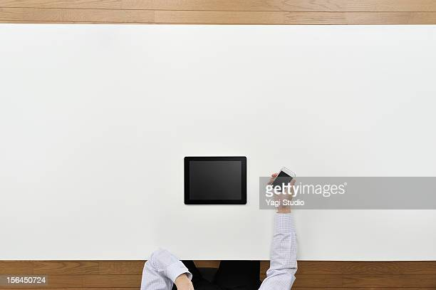 Businessman using  digital gadget