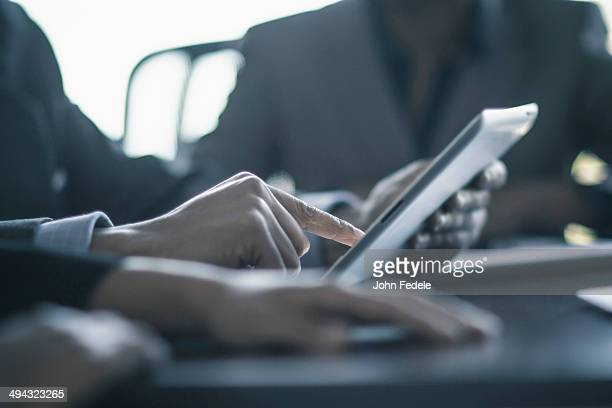 Businessman using digital tablet in meeting