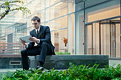 Businessman using digital tablet outdoors