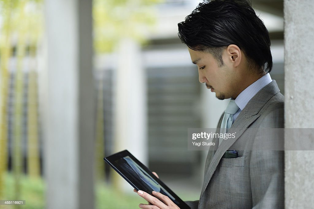 Businessman using digital tablet : Stock Photo