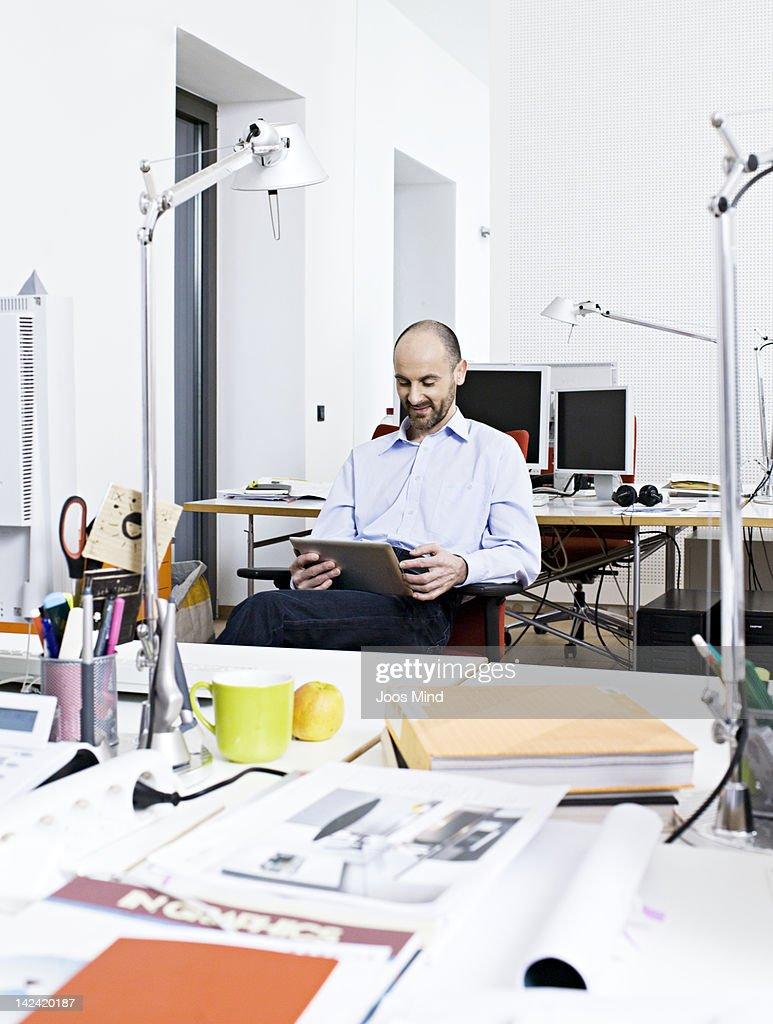 businessman using digital tablet, smiling : Stock Photo