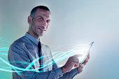 Businessman using digital tablet with lights
