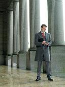 Businessman using electronic organiser