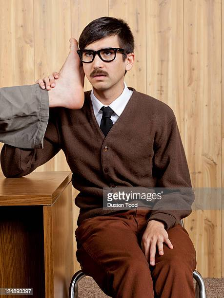 Businessman using foot phone in office