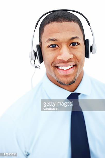 Businessman using headphones and smiling