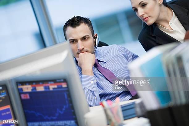 Businessman Using Headset Microphone