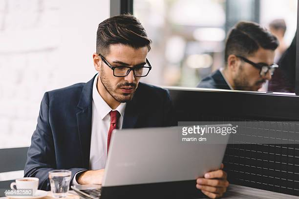 Businessman using lap top at the cafe