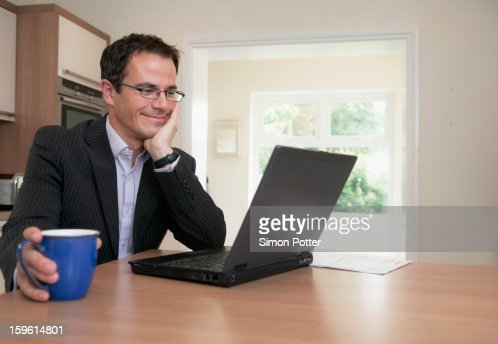 Businessman using laptop at breakfast : Stockfoto