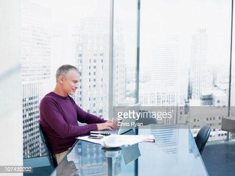 Businessman using laptop at desk : Stock Photo