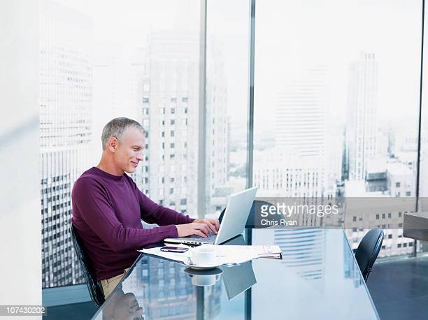 Businessman using laptop at desk