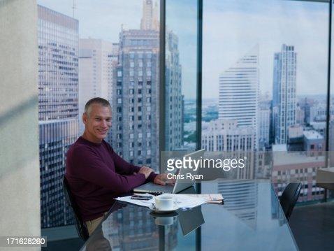 Businessman using laptop at desk : Stock Photo