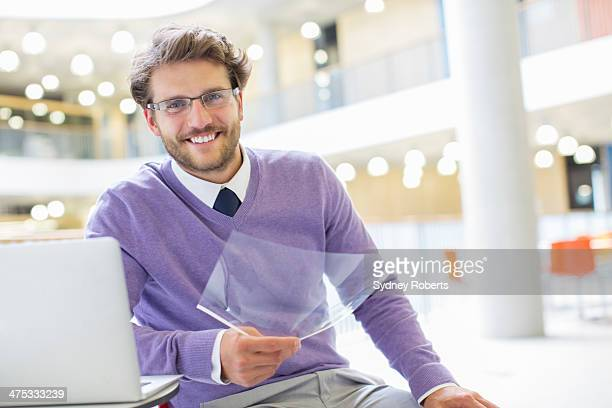 Businessman using laptop in modern office
