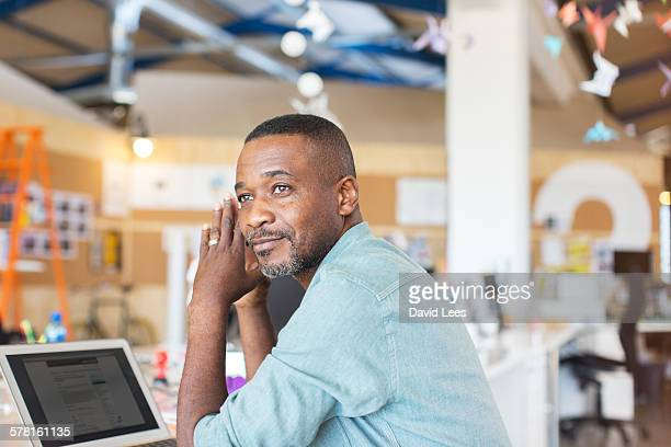 Businessman using laptop in office