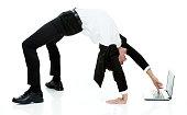 Businessman using laptop in yoga posturehttp://www.twodozendesign.info/i/1.png