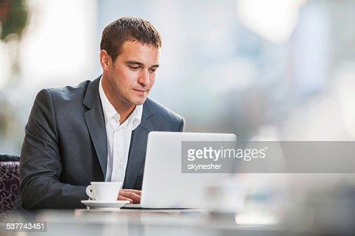 Businessman using laptop on a break.